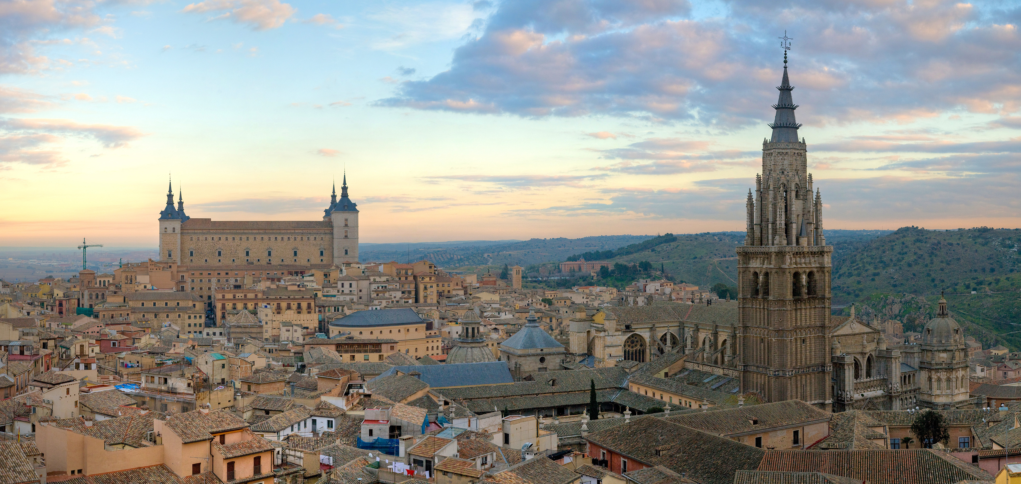 Toledo at sunset — The Alcázar on the left and Cathedral on the right.